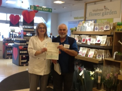 Dave Collecting Cheque from Waitrose with Angela Brown (Waitrose community engagement person); Feb 2017